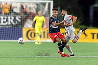 FOXBOROUGH, MA - JULY 7: Brando Bye #15 of New England Revolution and Alejandron Pozuelo #10 of Toronto FC battle for the ball during a game between Toronto FC and New England Revolution at Gillette Stadium on July 7, 2021 in Foxborough, Massachusetts.