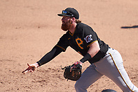 Pittsburgh Pirates first baseman Colin Moran (19) flips the ball to the pitcher covering during a Major League Spring Training game against the Baltimore Orioles on February 28, 2021 at Ed Smith Stadium in Sarasota, Florida.  (Mike Janes/Four Seam Images)