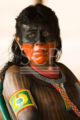 Pará State, Brazil. Aldeia Kokraimoro (Kayapo). Koti Kayapo with bright red urucum and black genipapo face paint.
