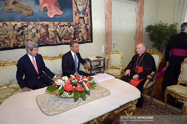 Secretary of State John Kerry;Secretary of State Vatican Parolin,Pope Francis during a meeting with U.S. President Barack Obama  a private audience in his private library at the Vatican on March 27, 2014.