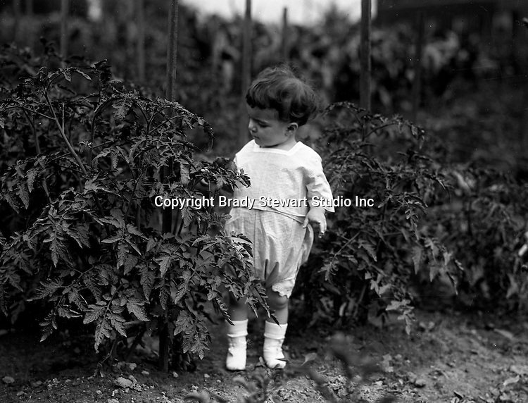 Point Breeze:  Helen Stewart walking in her grandfather's Victory Garden. During this time the Stewart's lived at 6705 Thomas Street in Point Breeze