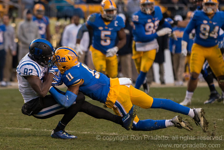 Pitt defensive back Dane Jackson (11) makes a tackle. The Pitt Panther defeated the Duke Blue Devils 56-14 at Heinz Field in Pittsburgh, Pennsylvania on November 19, 2016.