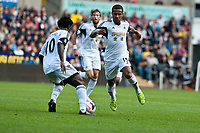 Saturday 19 October 2013 Pictured: Wilfried Bony passes the ball through to Wayne Routledge of Swansea<br /> Re: Barclays Premier League Swansea City vSunderland at the Liberty Stadium, Swansea, Wales