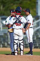 Danville Braves pitching coach Kanekoa Texeira (right) has a meeting on the mound with relief pitcher Jacob Belinda (52) and catcher Ricardo Rodriguez (49) during the game against the Bristol Pirates at American Legion Post 325 Field on July 1, 2018 in Danville, Virginia. The Braves defeated the Pirates 3-2 in 10 innings. (Brian Westerholt/Four Seam Images)