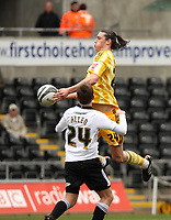 ATTENTION SPORTS PICTURE DESK<br /> Pictured: Joe Allen of Swansea City battles with Andy Carroll of Newcastle United<br /> Re: Coca Cola Championship, Swansea City Football Club v Newcastle United at the Liberty Stadium, Swansea, south Wales. 13 February 2010