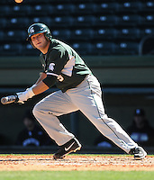 Right fielder Jimmy Pickens (9) of the Michigan State Spartans hits in a game against the Northwestern Wildcats on Sunday, February 17, 2013, at Fluor Field at the West End in Greenville, South Carolina. Michigan State won, 7-4. (Tom Priddy/Four Seam Images)