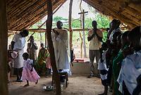 UGANDA, Karamoja, Kaabong, Karamojong Ethnie, Loyoro Parish, mission and mass in village church / Gottesdienst in einer kleinen provisorischen Kirche