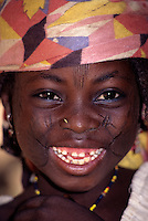 Maraka, Niger, Africa - Hausa Girl with Facial Scarification to Denote Tribal Affiliation.  A Piece of Straw in the Nostril Holds the Place for a Nose Ring.  West African portraits of ethnic Hausa, Fulani, Zarma (Djerma), and others from Niger, Ivory Coast, and Burkina Faso. Tell us what you need. West African portraits of ethnic Hausa, Fulani, Zarma (Djerma), and others from Niger, Ivory Coast, and Burkina Faso. Tell us what you need.