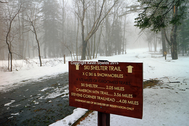 Sign in a state park in the late Winter, Camden, Maine.