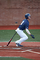 Carson Simpson (3) of the Wingate Bulldogs follows through on his swing against the Concord Mountain Lions at Ron Christopher Stadium on February 1, 2020 in Wingate, North Carolina. The Bulldogs defeated the Mountain Lions 8-0 in game one of a doubleheader. (Brian Westerholt/Four Seam Images)