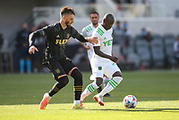 LOS ANGELES, CA - APRIL 17: Tristan Blackmon #27 of LAFC ego's after Kekuta Manneh #23 of Austin FC during a game between Austin FC and Los Angeles FC at Banc of California Stadium on April 17, 2021 in Los Angeles, California.