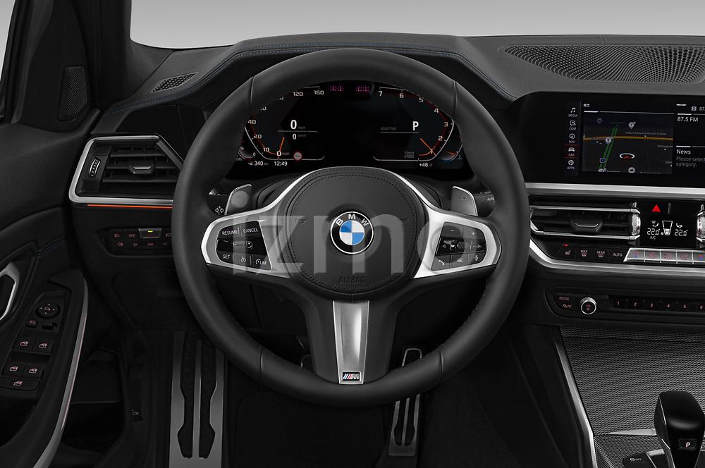 Car pictures of steering wheel view of a 2019 BMW 3-Series M-Sport 4 Door Sedan Steering Wheel