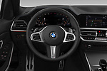 Car pictures of steering wheel view of a 2019 BMW 3-Series M-Sport 4 Door Sedan Steering Wheel