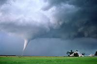 A slender white tornado threatens a farmstead. Stuart Nebraska, June 9th, 2003. (dig comp)
