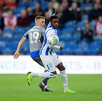 Lincoln City's Joe Morrell vies for possession with Huddersfield Town's Reece Brown<br /> <br /> Photographer Chris Vaughan/CameraSport<br /> <br /> The Carabao Cup First Round - Huddersfield Town v Lincoln City - Tuesday 13th August 2019 - John Smith's Stadium - Huddersfield<br />  <br /> World Copyright © 2019 CameraSport. All rights reserved. 43 Linden Ave. Countesthorpe. Leicester. England. LE8 5PG - Tel: +44 (0) 116 277 4147 - admin@camerasport.com - www.camerasport.com