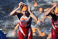 20 JUL 2013 - HAMBURG, GER - Kyle Jones (CAN) of Canada heads for transition at the end of the swim at the elite men's ITU 2013 World Triathlon Series round in the Altstadt Quarter, Hamburg, Germany (PHOTO COPYRIGHT © 2013 NIGEL FARROW, ALL RIGHTS RESERVED)