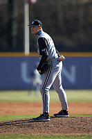Bryant Bulldogs relief pitcher John MacDonald (35) looks to his catcher for the sign against the High Point Panthers at Williard Stadium on February 21, 2021 in  Winston-Salem, North Carolina. The Panthers defeated the Bulldogs 3-2. (Brian Westerholt/Four Seam Images)