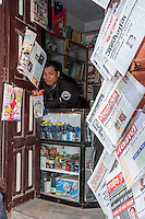 Nepal, Kathmandu.  Neighborhood Shop Vendor and Newspapers.