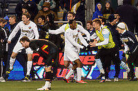 Notre Dame Fighting Irish defender Connor Miller (4) forward Leon Brown (9) and goalkeeper Brian Talcott (30) celebrate at the final whistle. The Notre Dame Fighting Irish defeated the Maryland Terrapins 2-1 during the championship match of the division 1 2013 NCAA  Men's Soccer College Cup at PPL Park in Chester, PA, on December 15, 2013.