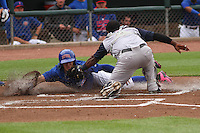Iowa Cubs shortstop Javier Baez (9) is tagged out at home by Colorado Springs Sky Sox catcher Robinzon Diaz (7) during a Pacific Coast League game on May 10th, 2015 at Principal Park in Des Moines, Iowa.  Iowa defeated Colorado Springs 14-2.  (Brad Krause/Four Seam Images)