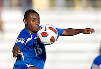 Carlos Valentin (15) of Honduras tries to control the ball during the quarterfinals of the CONCACAF Men's Under 17 Championship at Catherine Hall Stadium in Montego Bay, Jamaica. Jamaica defeated Honduras, 2-1.