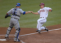 Jun 27, 2007; Phoenix, AZ, USA; Arizona Diamondbacks shortstop (6) Stephen Drew slides into home to score a run in the first inning against the Los Angeles Dodgers at Chase Field. Mandatory Credit: Mark J. Rebilas
