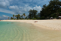 People sunbathing on Koh Lipe beautiful white sand beach, Thailand