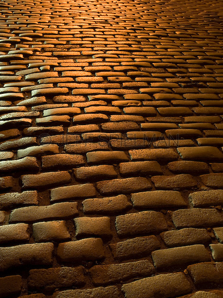 AVAILABLE FROM JEFF AS A FINE ART PRINT.<br /> <br /> AVAILABLE FROM GETTY IMAGES FOR COMMERCIAL AND EDITORIAL LICENSING.  Please go to www.gettyimages.com and search for #95933385.<br />  <br /> Close-up of Cobblestone Street Illuminated at Night in the DUMBO neighborhood of Brooklyn, New York City, New York State, USA