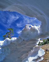 Water carved snow bridge. Lassen Volcanic National Park, CA.