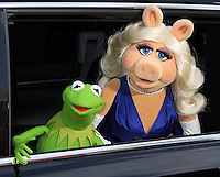 """HOLLYWOOD, LOS ANGELES, CA, USA - MARCH 11: Steve Whitmire, Kermit, Eric Jacobson, Miss Piggy at the World Premiere Of Disney's """"Muppets Most Wanted"""" held at the El Capitan Theatre on March 11, 2014 in Hollywood, Los Angeles, California, United States. (Photo by Xavier Collin/Celebrity Monitor)"""
