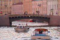 Saint Petersburg, Russia, June 2002..The mid-summer White Nights period when the sun sets only briefly is a time of festivals, entertainment and walks along the Neva River to watch the city bridges raise for shipping..