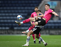 20th April 2021; Deepdale, Preston, Lancashire, England; English Football League Championship Football, Preston North End versus Derby County; George Edmundson of Derby County wins the ball from Ched Evans of Preston North End