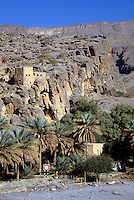 Nakhr, Wadi Ghul, Jebal Shams, Oman, Arabian Peninsula, Middle East - The abandoned houses and watchtowers of the village of Nakhr stand as a testimony to Oman's recent past.  Such buildings would have been lived in until the 1970s.  These old stone buildings have now been replaced by newer, concrete block and mortar constructions.