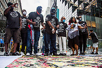 NEW YORK, NY - JULY 31: George Floyd's brother Terrence Floyd, along with friends and artisans, paints with his hands a banner of his brother George Floyd in front of the Trump Tower on 5 Av on July 31, 2020 in New York City. Since the murder of George Floyd by a Minneapolis police officer on May 25, millions of Americans have taken to the streets demanding more police accountability, reform and, in some cases, a lack of police funds. Many of the events took place next to the Trump Tower at 5 Av in Manhattan. (Photo by Pablo Monsalve / VIEWpress)
