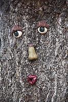 A tree decorated like a Mr. (or Miss) Potato Head puckers up, inviting a big smacker.  Pumpkin Depot, Half Moon Bay.