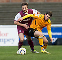 Arbroath's Adam Hunter and Annan's Josh Todd challenge for the ball.