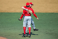 Radford Highlanders starting pitcher Danny Hrbek (7) gets a hug from third baseman Matt Roth (30) after throwing a no-hitter against the Quinnipiac Bobcats at David F. Couch Ballpark on March 4, 2017 in Winston-Salem, North Carolina.  The Highlanders defeated the Bobcats 4-0.  (Brian Westerholt/Four Seam Images)