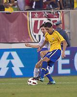 USA midfielder Sacha Kljestan (16) challenges Brazil midfielder Paulo Henrique Ganso (10). Brazil  defeated the US men's national team, 2-0, in a friendly at Meadowlands Stadium on August 10, 2010.