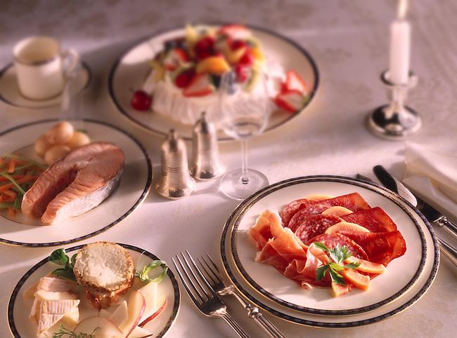 Table setting of starter - Charcutterie - Main Course - Salmon Steak - Dessert - Pavlova