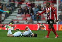 SUNDERLAND, ENGLAND - MAY 13: Gylfi Sigurdsson of Swansea City lies on the ground after being fouled by Wahbi Khazri of Sunderland during the Premier League match between Sunderland and Swansea City at the Stadium of Light, Sunderland, England, UK. Saturday 13 May 2017