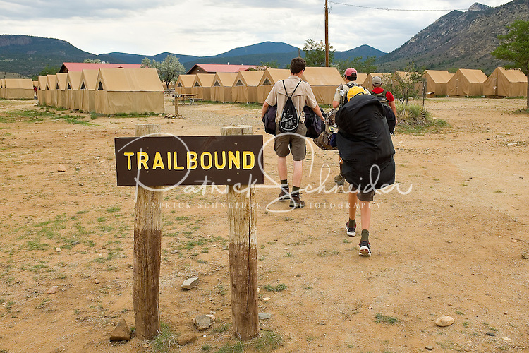 Photo story of Philmont Scout Ranch in Cimarron, New Mexico, taken during a Boy Scout Troop backpack trip in the summer of 2013. Photo is part of a comprehensive picture package which shows in-depth photography of a BSA Ventures crew on a trek. In this photo, newly arrived Boy Scouts move into base camp at Philmont as they prepared for next day departure for the backcountry.<br /> <br /> Photo by travel photograph: PatrickschneiderPhoto.com