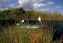 Bass fishing in a Florida Everglades canal along US41. john gillan; gillan; miami stock; Florida;