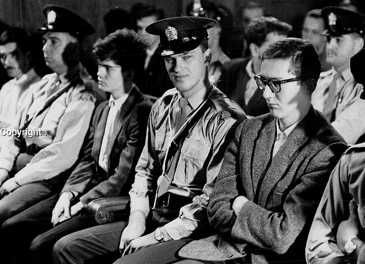 Francois Gagnon; Student and other<br /> FLQ Bomb suspects sit in court today surrounded by Montreal and Quebec provincial police. FLQ is a terrorist organization dedicated to the removal of Quebec from Confederation. The suspects for the most part were young and shabbily dressed. They all were in need of haircuts.<br /> <br /> 1963<br /> <br /> PHOTO :  Frank Grant - Toronto Star Archives - AQP