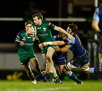 20th February 2021; Galway Sportsgrounds, Galway, Connacht, Ireland; Guinness Pro 14 Rugby, Connacht versus Cardiff Blues; Jack Carty (Connacht) holds off a challenge from Liam Belcher (Cardiff Blues)