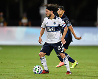 LAKE BUENA VISTA, FL - JULY 26: Russell Teibert of Vancouver Whitecaps FC in possession during a game between Vancouver Whitecaps and Sporting Kansas City at ESPN Wide World of Sports on July 26, 2020 in Lake Buena Vista, Florida.