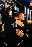 Nov. 13, 2011; Pomona, CA, USA; NHRA top fuel dragster driver Del Worsham (right) celebrates with teammate Larry Dixon after clinching the world championship at the Auto Club Finals at Auto Club Raceway at Pomona. Mandatory Credit: Mark J. Rebilas-.