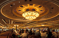 Las Vegas, casino, gamble, Nevada, NV, The Strip, People gambling inside the casino at the Monte Carlo Resort & Casino in Las Vegas, the Entertainment Capital of the World.
