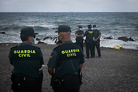 CEUTA, SPAIN ‐ MAY 20: A body bag lies at the shore across the border between morocco and Spain as civil guards stand at the beach of Tarajal on May 20, 2021 in Ceuta, Spain.  After a diplomatic conflict between Spain and Morocco, thousands of migrants who have taken advantage of the little Moroccan police activity on the border to cross it mainly by swimming, which has caused a migration crisis with the entry of more than 8000 migrants from the African country. (Photo by Joan Amengual/VIEWpress )