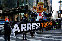 NEW YORK, NEW YORK - MARCH 08: People hold a placard during a protest against the former U.S. president Donald Trump at Trump Tower on March 08, 2021 in New York. Trump is returning to New York for the first time after leaving the White House at a time when several New York prosecutors are investigating his businesses for possible fraud crimes. (Photo by John Smith/VIEWpress)