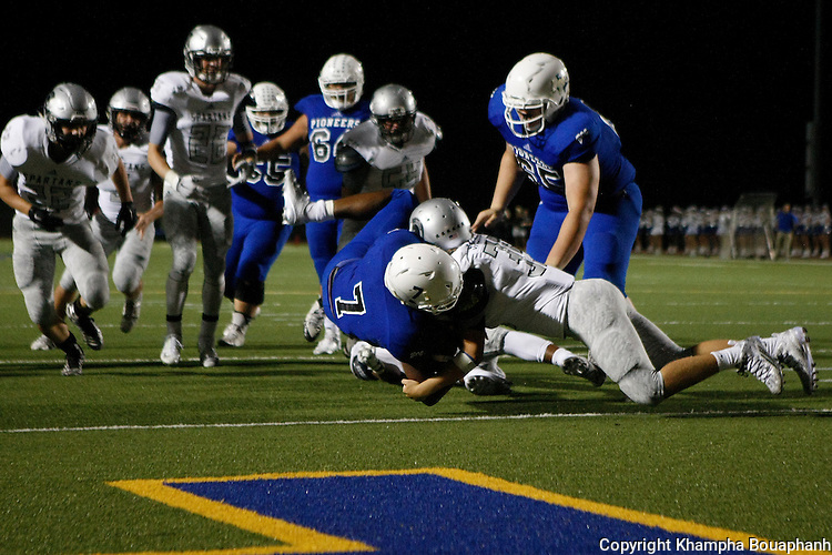 Boswell senior quarterback Anthony Ramirez runs in the winning touchdown to beat Burleson Centennial 41-38 in two overtimes during a high school football in Fort Worth on Friday, September 11, 2015. (photo by Khampha Bouaphanh)